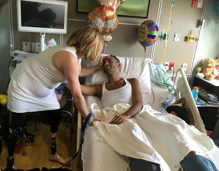 Angel Colon, Pulse shooting survivor is comforted by Boston bombing survivor Celeste Corcoran in his hospital room at Orlando Regional Medical Center.