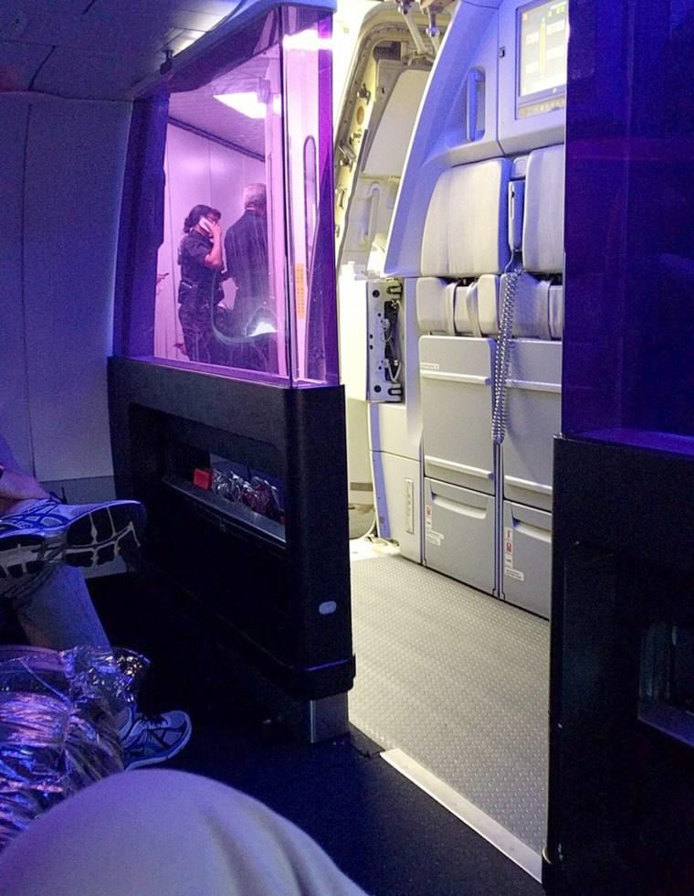 Police on a Virgin American flight that made an emergency landing in Denver.