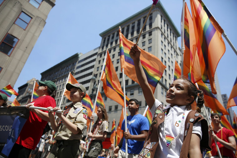 Image: People take part in the annual NYC Pride parade in New York City