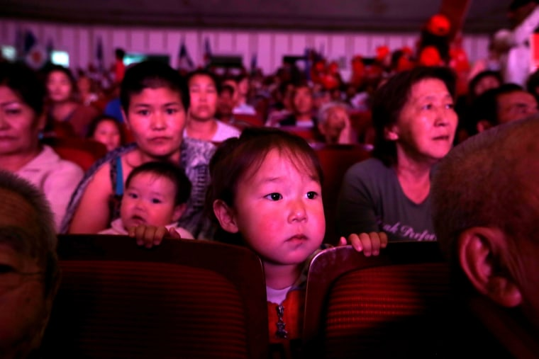 Image: Supporters of Mongolian People's Revolutionary Party and their children attend a rally for the upcoming parliamentary elections in Ulan Bator