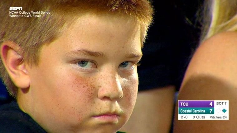 Kid stares down camera at ballgame