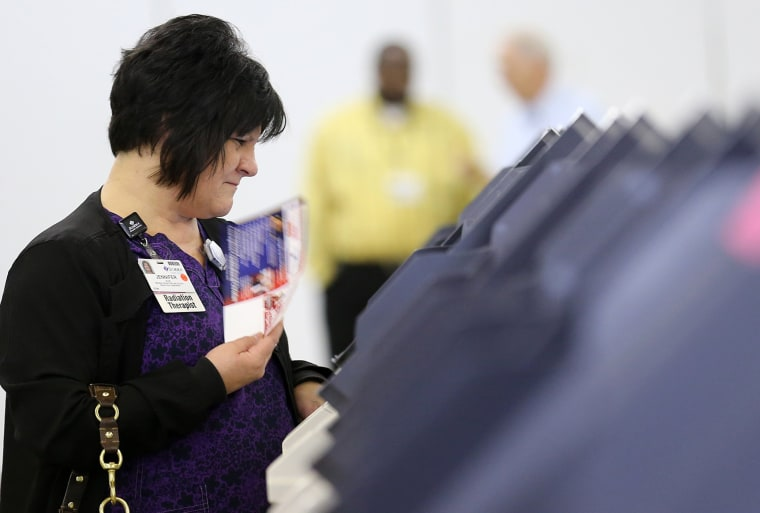 Image: An Ohio voter casts her ballot on Super Tuesday in Ohio