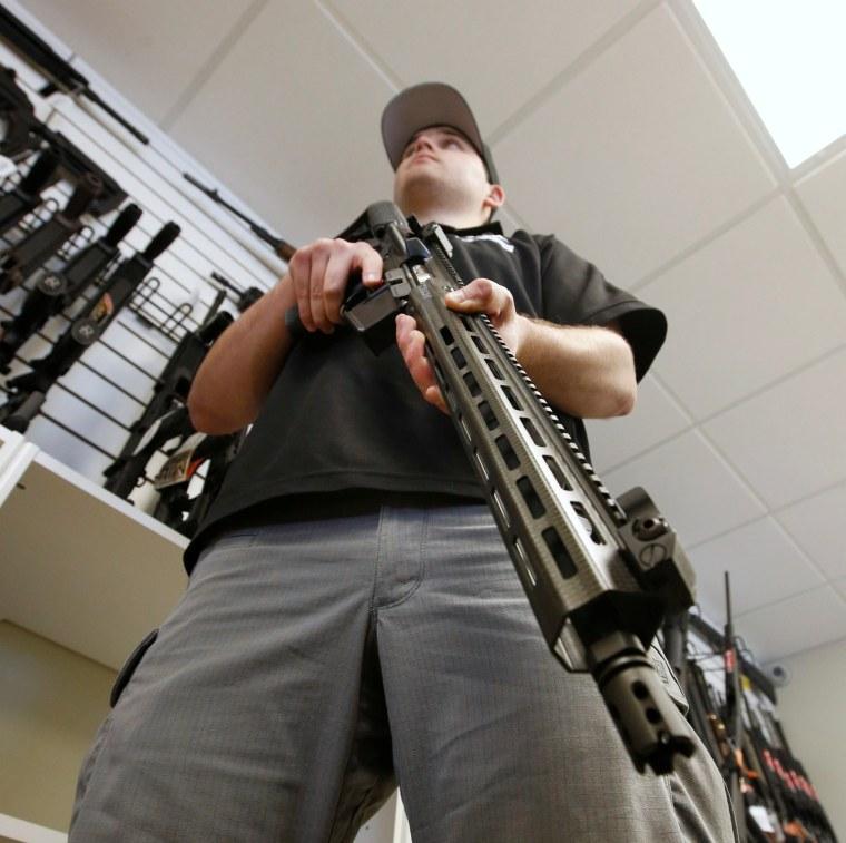 Image: Salesman with AR-15 at Utah gun store