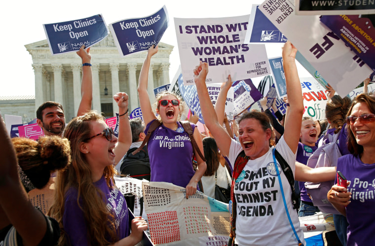 Image: Demonstrators celebrate outside the U.S. Supreme Court in Washington