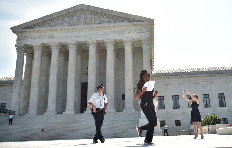 Image: A reporter runs out of the court shortly after the decision was announced