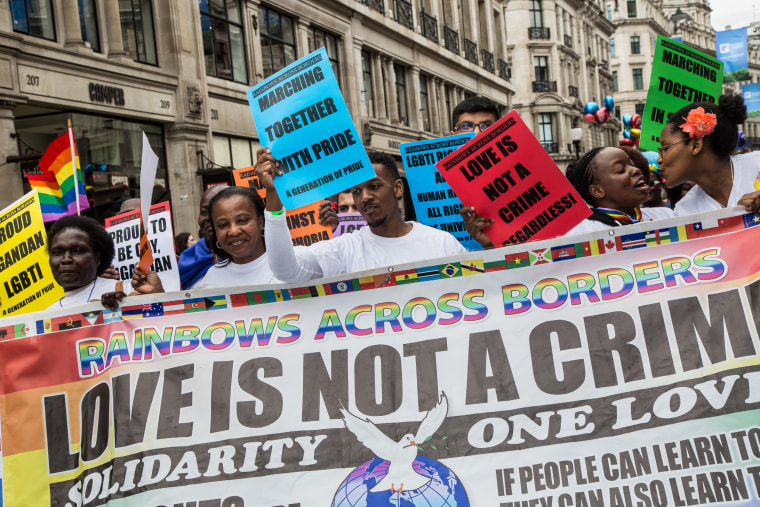 Participants in the Pride London march in celebration of the LGBTQ community in Trafalgar Square on June 25, 2016.