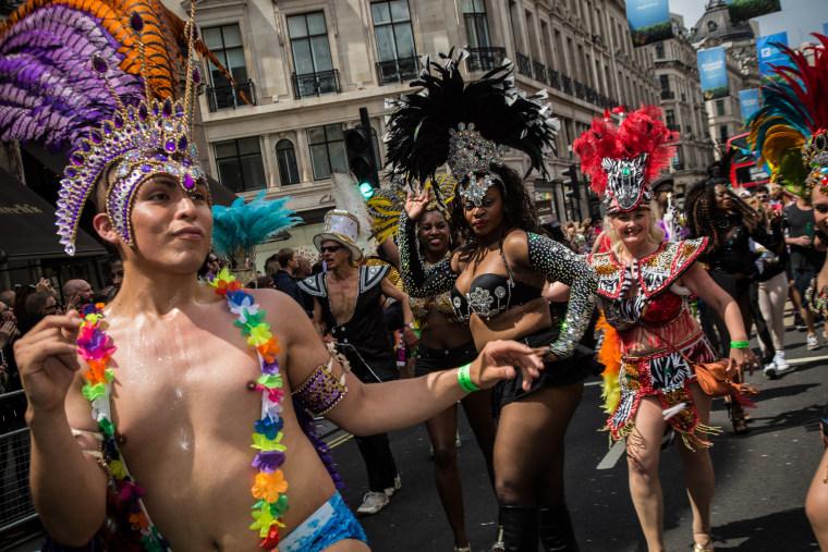 Participants in the Pride London march in celebration of the LGBTQ community in Trafalgar Square on June 25, 2016.