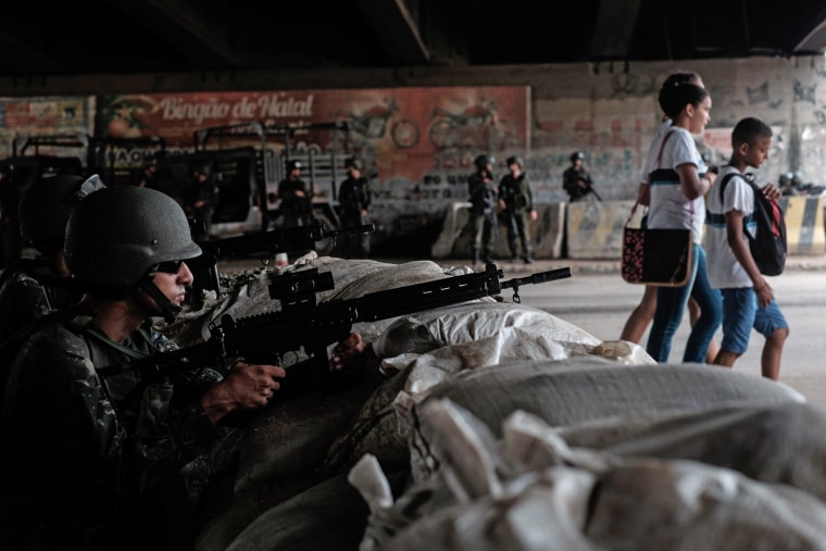 Soldiers of the Brazilian Army take positions at a checkpoint during a security operation