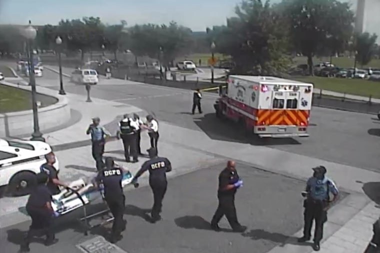 Washington, DC Fire Department personnel wheel Jessie Olivieri to a waiting ambulance May 20 after he was shot by officers for refusing to drop a handgun he was carrying. Still frame from a Secret Service surveillance video shown in federal court Monday.