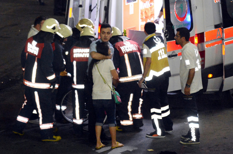 Image: Paramedics help injured outside Turkey's largest airport, Istanbul Ataturk following a blast