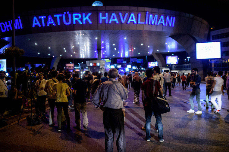 Image: People wait outside the Ataturk airport in Istanbul