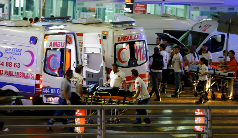 Image: Paramedics push a stretcher at Turkey's largest airport, Istanbul Ataturk