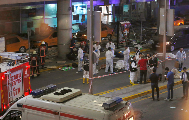 Image: Forensic experts work outside Turkey's largest airport, Istanbul Ataturk, Turkey, following a blast