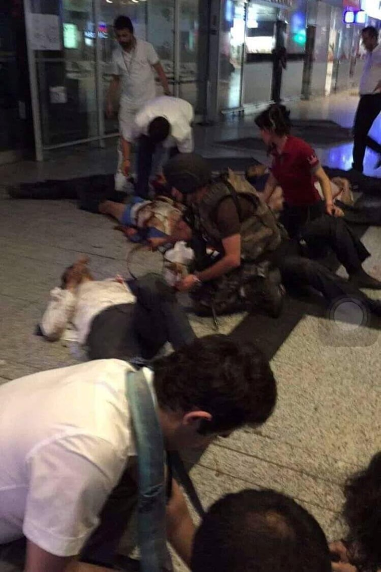 Image: A view of the entrance of the Ataturk international airport after two suicide bombers opened fire before blowing themselves up at the entrance, in Istanbul, Turkey