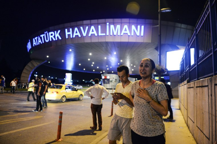 Image: People stand outside Istanbul's Ataturk airport