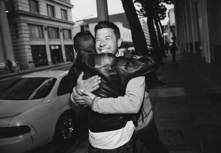 Image: Sam Dodge, the Director of the Mayor's Office of HOPE, runs into a formerly homeless man who is now housed and a DPW worker in the Tenderloin in San Francisco, California