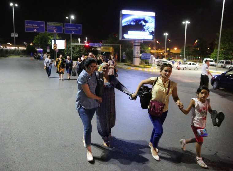 Image: People walk away from Istanbul Ataturk airport, Turkey