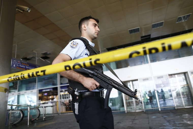 Image: Armed Turkish police officer at Ataturk Airport in Istanbul