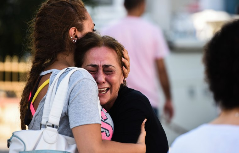 Image: A mother of a victim reacts after Ataturk airport attack