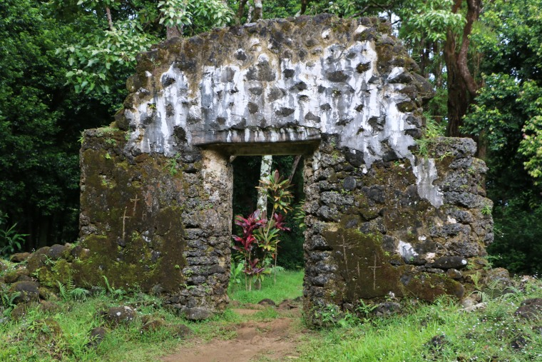 This undated photo, provided by the Hawaii Department of Land and Natural Resources, shows the crumbling remains of the 180-year-old summer palace of former King Kamehameha III where vandals etched crosses in the forest of a Honolulu, Hawaii, neighborhood. The Department said Thursday, June 23, 2016, that unless the vandals are caught desecrating the sacred cultural site, there's little law enforcement officers can do.