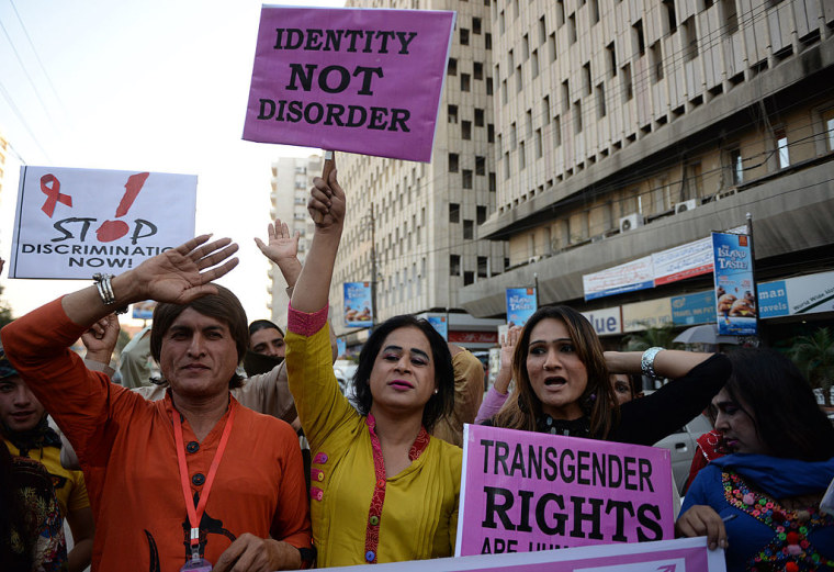 Transgender people in Pakistan carry placards as they rally to mark World Aids Day in Karachi on November 30, 2013.