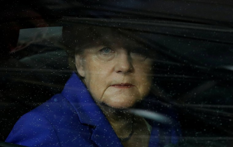 Image: German Chancellor Angela Merkel arrives on the second day of the EU Summit in Brussels, Belgium.