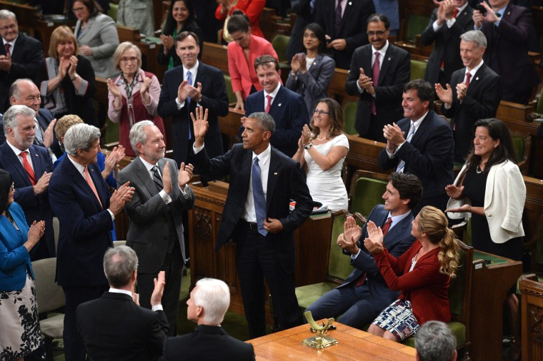 Image: President Barack Obama is greeted by a standing ovation in the House of Commons