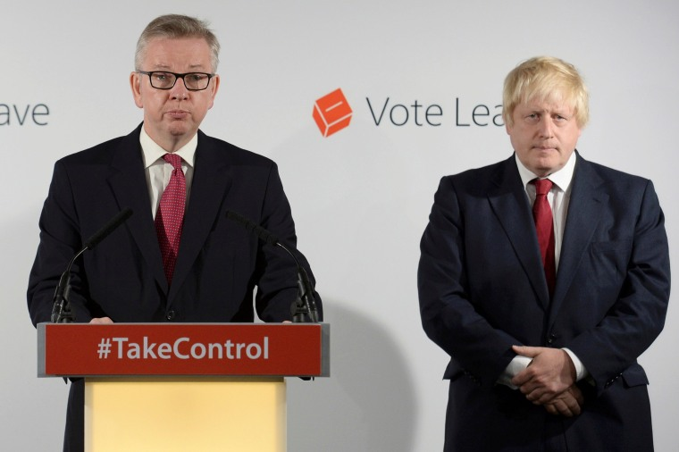 Image: Britain's Justice Secretary Michael Gove speaks as Vote Leave campaign leader Boris Johnson listens at the group