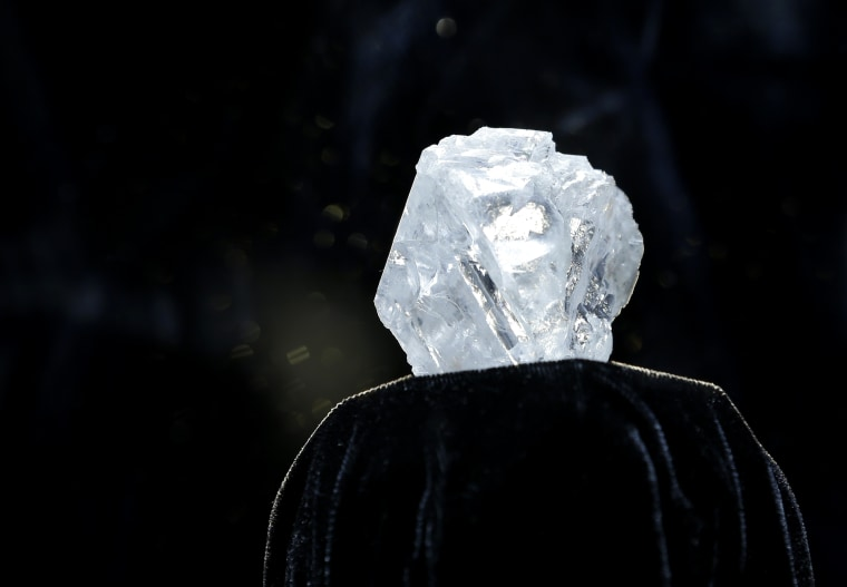 A large diamond is displayed at Sotheby's in New York, Wednesday, May 4, 2016. A 3-billion-year-old diamond the size of a tennis ball ? the largest discovered in over a century.