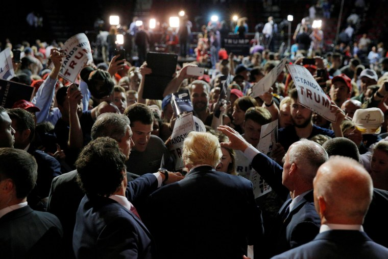 Image: U.S. Republican presidential candidate Donald Trump greets audience members at a campaign rally in Bangor