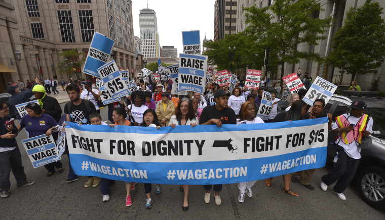 Workers protest growing wage inequality.