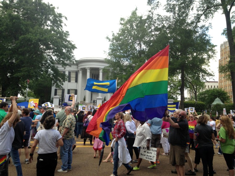 Image: Protestors march seeking repeal of a Mississippi law allowing religious groups  to deny services to same-sex couples, transgender people and others