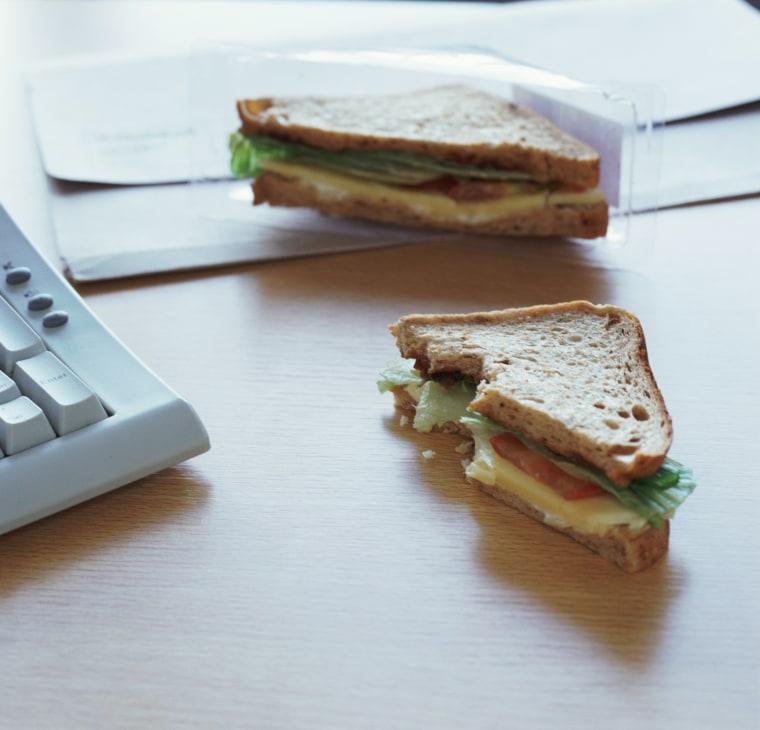 Image:Half eated sandwich on desk by computer keyboard