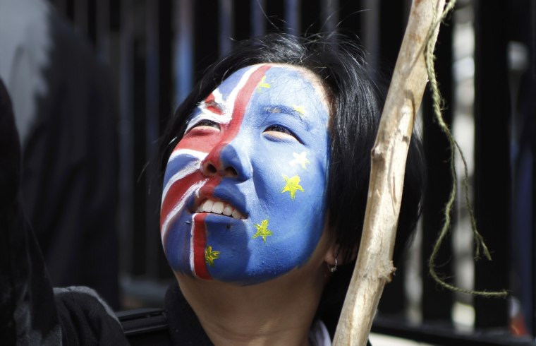 A woman looks upwards during the 'March for Europe' demonstration against Britain's decision to leave the European Union, in London, on July 2.