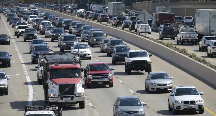 Drivers work their way out of Dallas during rush hour on July 1, 2016. As more travelers are driving, traffic deaths surged last year as drivers racked up more miles behind the wheel than ever before, a result of an improved economy and lower gas prices, according to preliminary government data released.