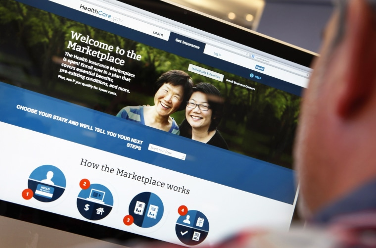 Image: A man looks over the Affordable Care Act signup page on the HealthCare.gov website in New York in this photo illustration