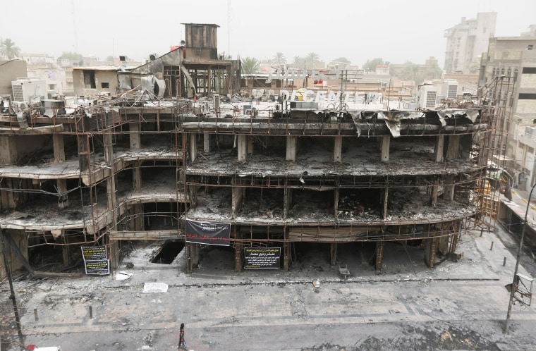 Image: The site of a suicide car bomb attack in Baghdad