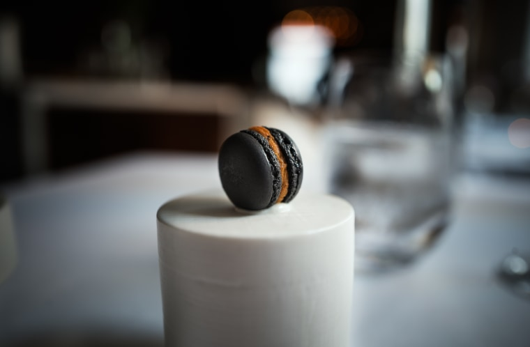 A macaron filled with jeyuk, Korean spicy pork, from the KoreaNYC restaurant event at Jungsik in New York City.