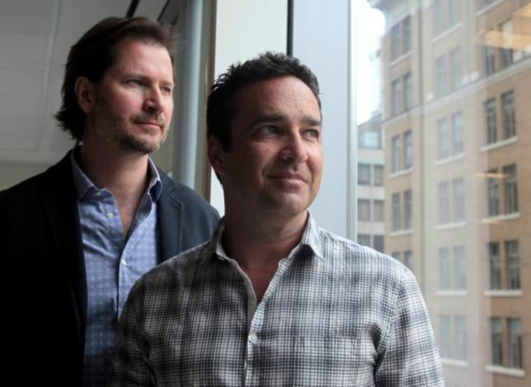Online dating agency Ashley Madison's CEO Rob Segal and president James  Millership pose during an interview