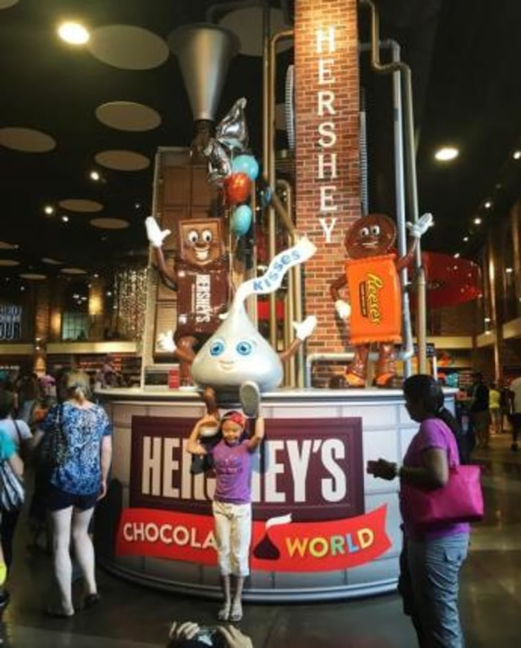 Visitors pose in Hershey's Chocolate World, a sprawling candy and chocolate store in Hershey
