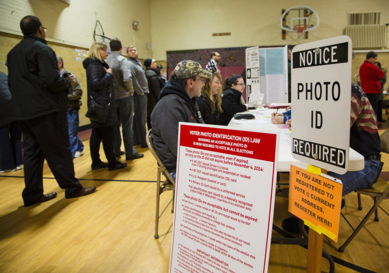 Image: Voters take to the polls in Wauwatosa, Wisconsin