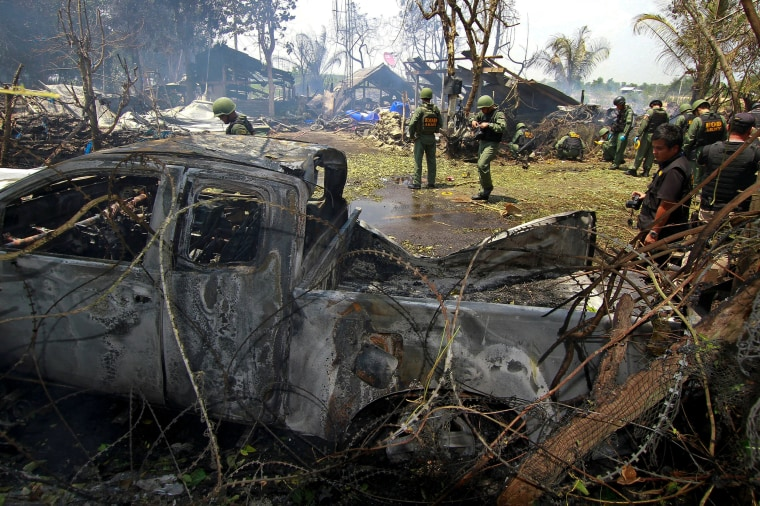 Image: Thai EOD personnel inspect the site of a bomb attack where police officers were injured, at Nong Chik district in the troubled southern province of Pattani