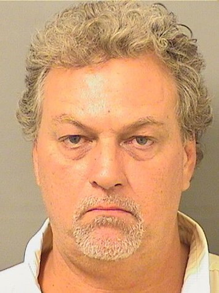 Glenn Shaw is seen in this booking photo provided by the Palm Beach Sheriff's Office. He is accused of taking more than 100 eggs from a loggerhead sea turtle as the turtle was laying them on Jupiter Island, Florida.