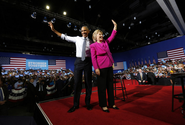 U.S. President Obama stands with Democratic U.S. presidential candidate Clinton at campaign event in Charlotte, North Carolina
