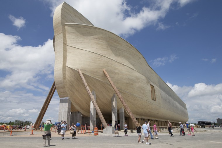 Noahs ark of biblical proportions ready to open in kentucky visitors pass outside the front of a replica noahs ark at the ark encounter theme park during a media preview day tuesday july 5 2016 in williamstown malvernweather Gallery