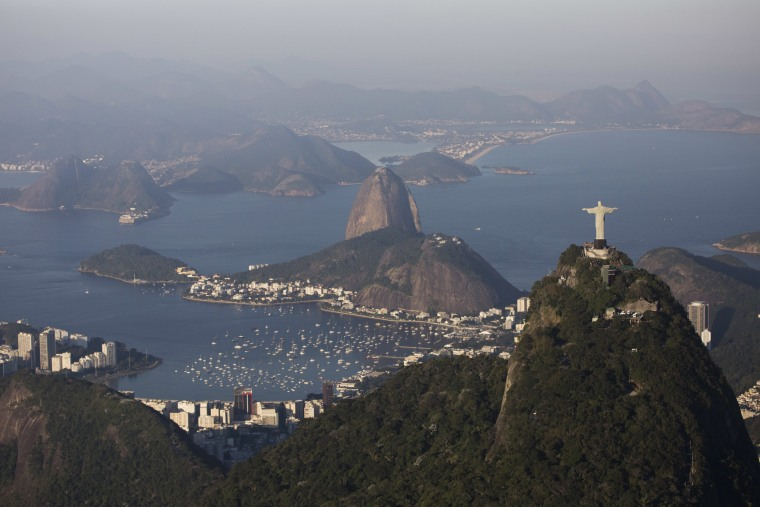 Image: The Sugar loaf and Guanabara bay are seen behind the Christ the Redeemer statue in Rio de Janeiro