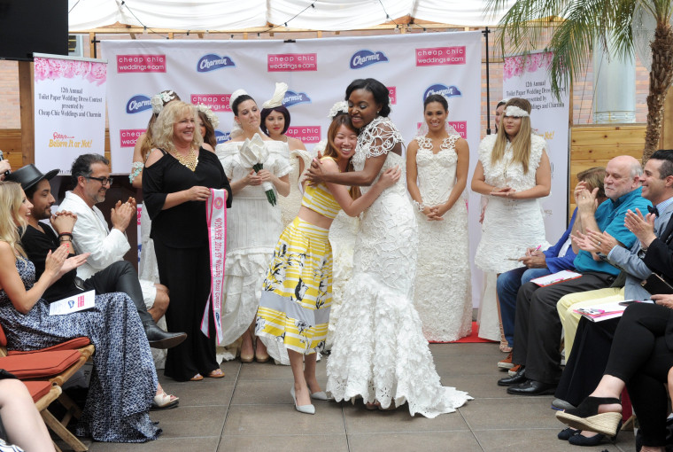 Designer Van Tran Of Brooklyn Ny Hugs Her Model After Winning A 10 000 Grand Prize At The 12th Annual Toilet Paper Wedding Dress Contest Presented By