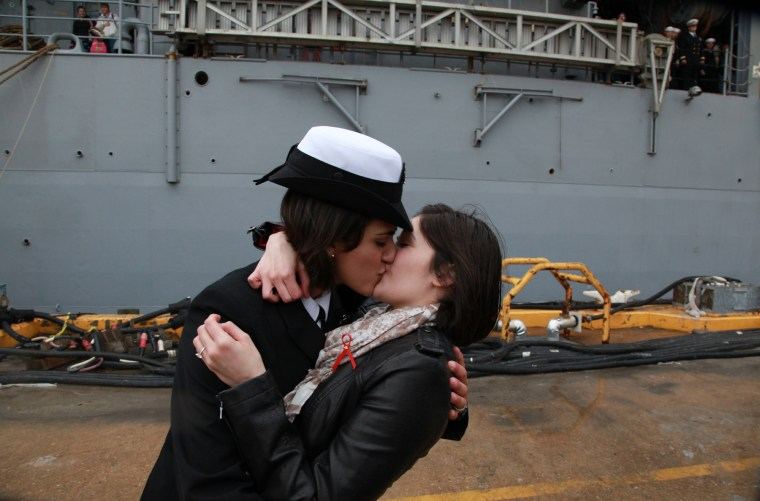 Petty Officer 2nd Class Marissa Gaeta, left, kisses her girlfriend of two years, Petty Officer 3rd Class Citlalic Snell at Joint Expeditionary Base Little Creek in Virginia Beach, Va., Wednesday, Dec. 22, 2011.