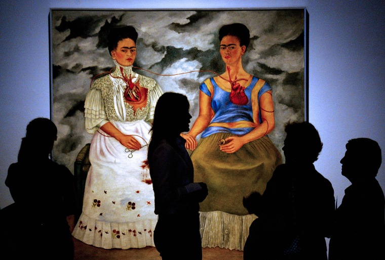 "People look at the 1939 painting ""Las Dos Fridas"""