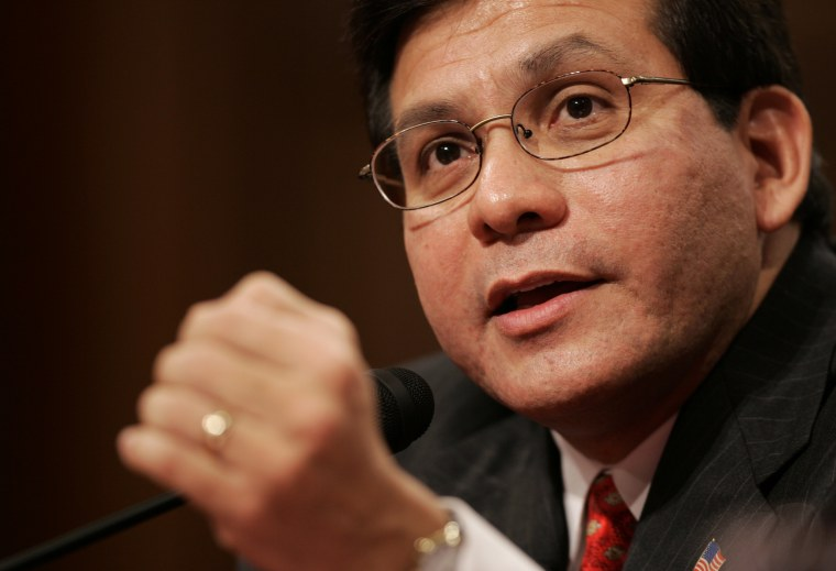 Image: Attorney General nominee Alberto Gonzales gestures during a Senate Judiciary Committee confirmation hearing
